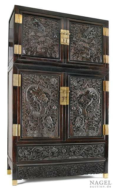 A pair of impressive and large hardwood compound cabinets with carved zitan panels, China, Qing dynasty. Photo Nagel Auktionen