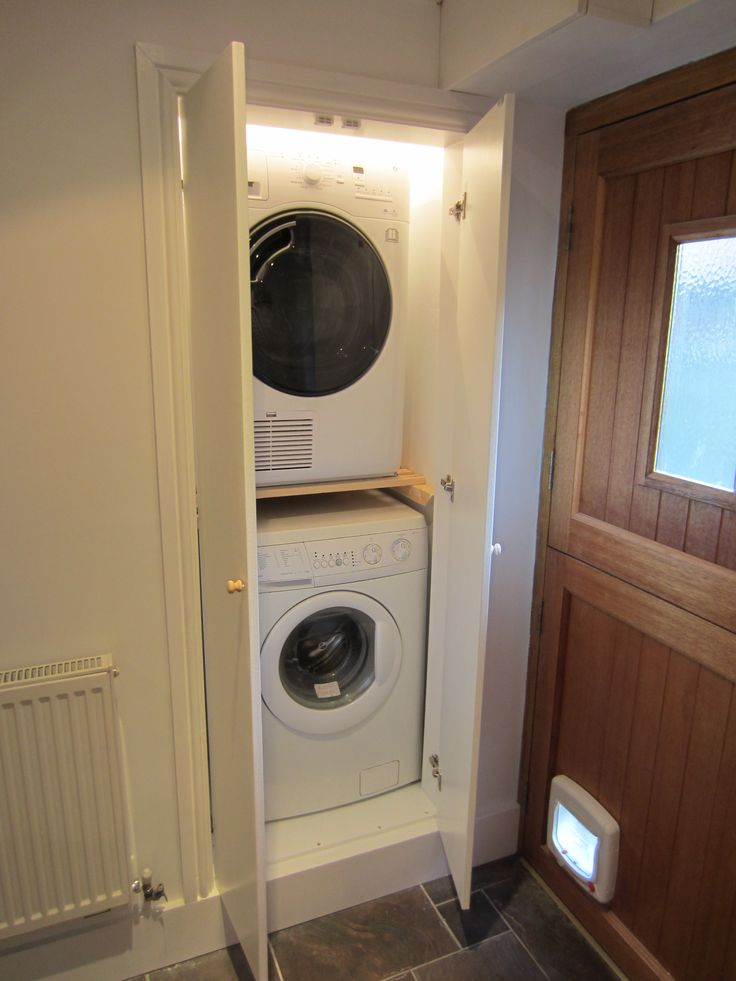 Space was taken from an adjoining room to create this utility cupboard.
