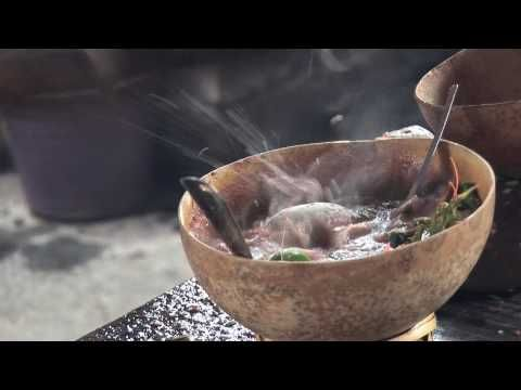 """Caldo de Piedra """"Stone Soup"""" (mini doc in HD by Sarah Borealis, 2009).  Caldo de piedra, """"stone soup"""" is a traditional dish of the chinanteco ethnic group of Oaxaca and dates back to prehispanic times.     To make the stone soup, fish or seafood is placed in a gourd bowl along with a tomato-based broth and seasonings, then a hot river rock taken directly from the fire is placed in the gourd, where it sizzles and cooks the soup in a matter of instants."""