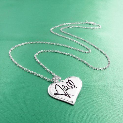 One Direction 'Niall Signature' Heart Necklace One Direction Official Jewelry. $17.99. Official One Direction Merchandise. Black enamel 'Niall Horan' signature on front. Embossed 1D logo on back. Save 10% Off!
