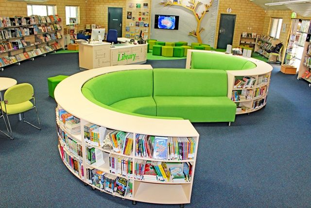 We would like to thank the lovely staff at Ranford Primary School! This library turned out amazingly we are very proud of this project. The library seating with shelving works exceptionally well in this space. The circulation desk that we did was further enhanced with the vinyl lettering the school added.