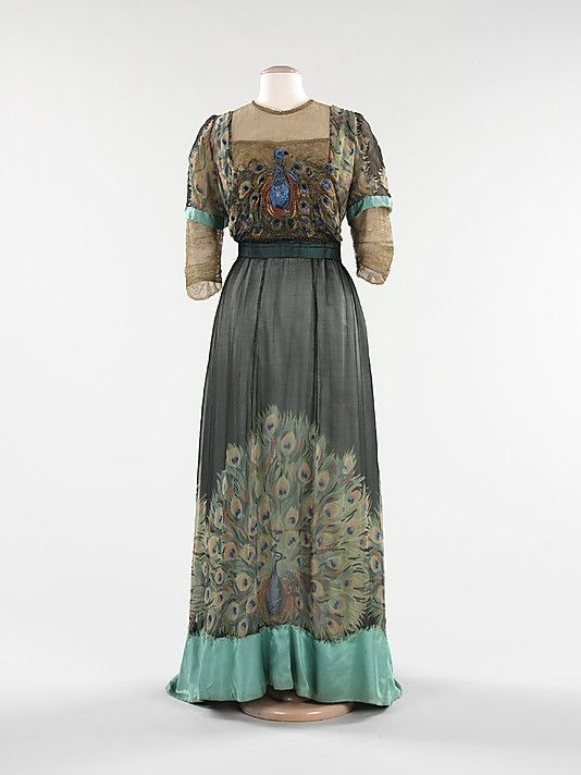 Evening dress by Weeks, 1910 Paris, the Met Museum  Associated with royalty and symbolizing beauty, immortality and  exoticism, the peacock has long been a favorite motif of artists.  Particularly during the Art Nouveau movement, designers incorporated the  birds into their work, inspired by the creatures' sinuous bodies and  showy feathers. In this gown, by the little-known Parisian house of  Weeks, both printed and embroidered peacock motifs enliven the skirt and  bodice.1910 S, Met Museums, Evening Dresses, Art Nouveau, Dresses Collection, 1910 Peacocks, Peacocks Dresses, Brooklyn Museums, Metropolitan Museums