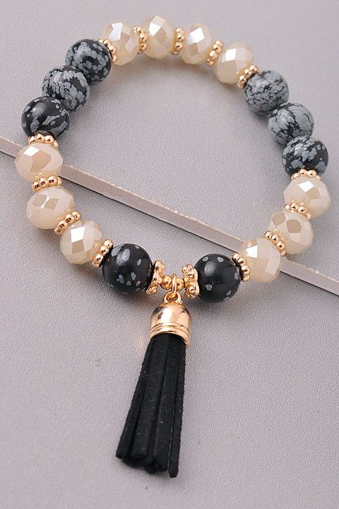 Beaded bracelet with a tassel - Stretches - one size fits most