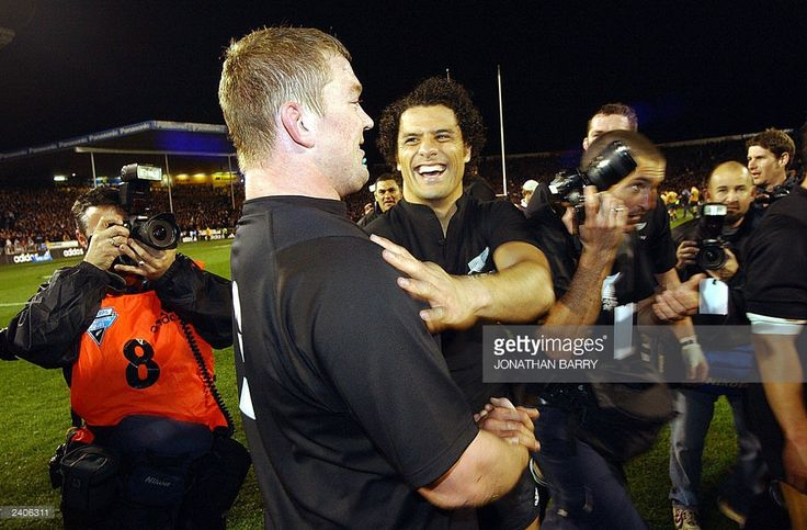 New Zealand All Blacks Doug Howlett (Right) congrtulates All Black team mate Greg Somerville (Left) following the final whistle, which saw the All Blacks beat Australia 21-17 to win the Beldisloe Cup at Eden Park, Auckland. AFP PHOTO/Jonathan BARRY