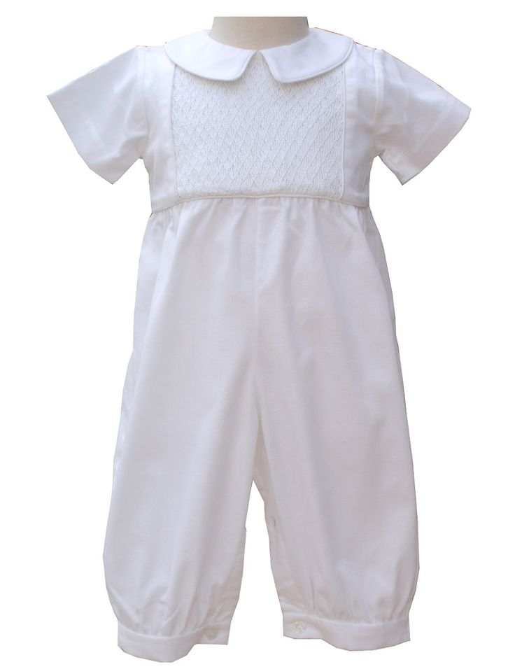 It is an all white one piece made of 100% Cotton. There is a panel of hand smocking in a diamond pattern on the chest. It has a Peter Pan collar, short sleeves, gathered pant legs, and buttons down the back for easy on and off.