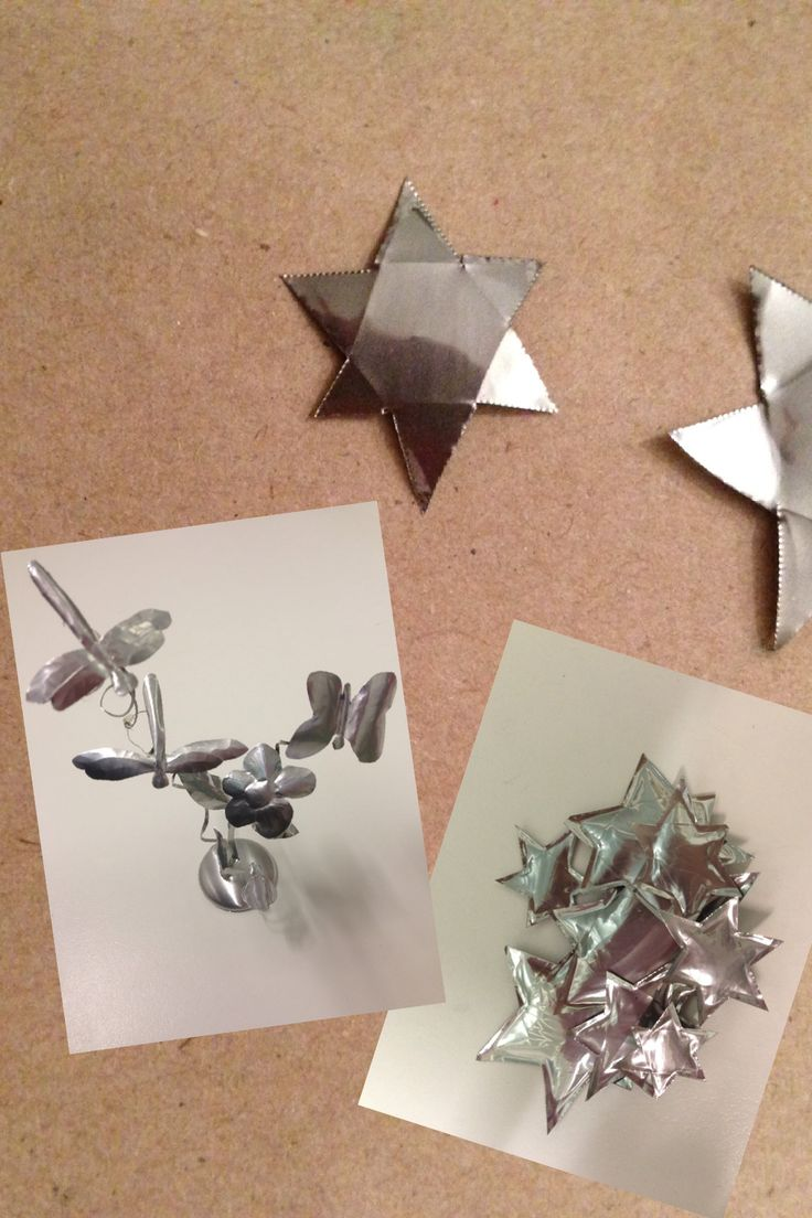 Figuras de metal con latas recortadas