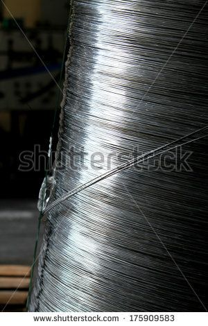 Aluminum wire in a coil - stock photo