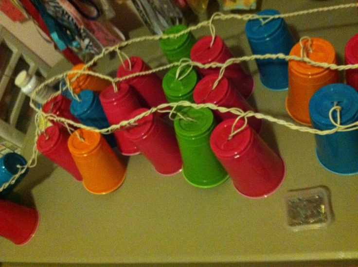 Hanging outside party lights made from Solo cups. Super cute