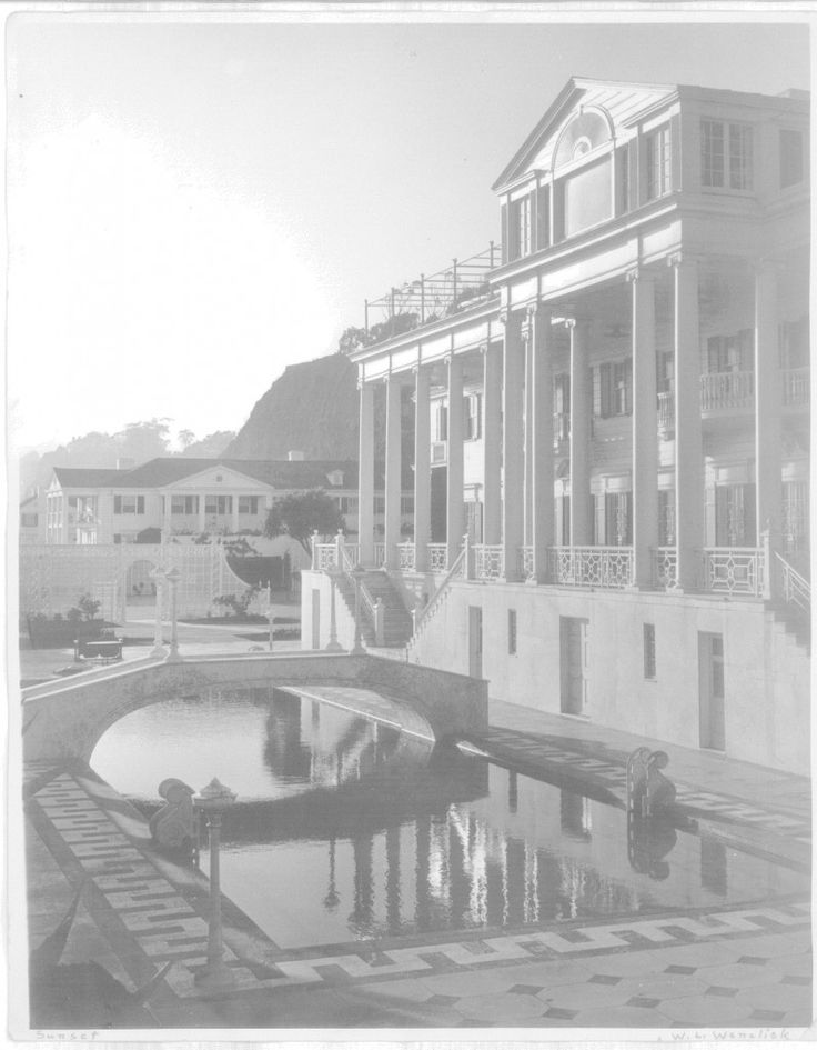 Original photograph of Marion Davies Santa Monica beach house in 1929. It had 34 bedrooms, 55 bathrooms and 3 separate guest houses, as well as a tennis court and swimming pool. After Marion sold it in 1947, it was a hotel called Oceanhouse. In 1956, it became the Sand and Sea Beach Club. The house was badly damaged in an earthquake in the 1990's and it soon fell into severe disrepair. The majority of the property had to be torn down, leaving only one guest house and the original pool.