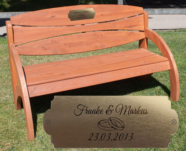 Wooden bench with plaque.