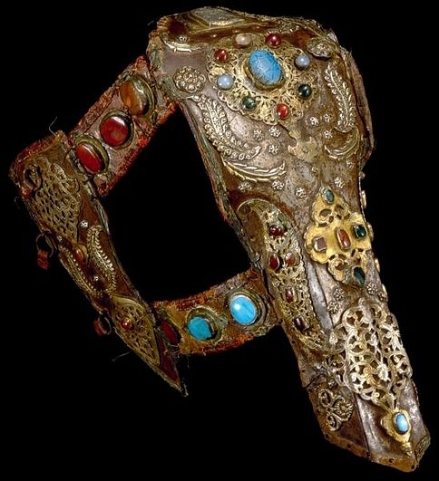 Chamfron and cheek-pieces. Ottoman Turkey or Egypt, 18th century; forged iron or steel, leather, silver-gilt appliqués, cornelian, agate, coloured glass, jade and gold encrustation, height 54.5 cm. Nasser D. Khalili Collection of Islamic Art.
