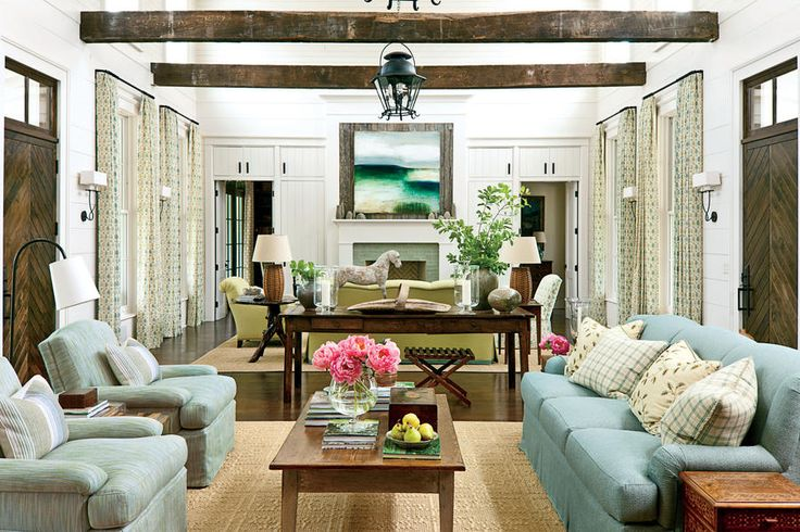 "Balance Rustic Elements - 108 Living Room Decorating Ideas - Southernliving. Front and back doors open directly into a two-story-high living room, where spruce-planked walls and wood beams salvaged from an 1890 Tennessee barn reflect the home's rural setting and give the space a refined, barnlike feel. Interior decorator Phoebe Howard balanced the rustic elements with color. ""I added an air of elegance with a soft color palette that reflects the surrounding sky and hills,"" she says.  Video…"
