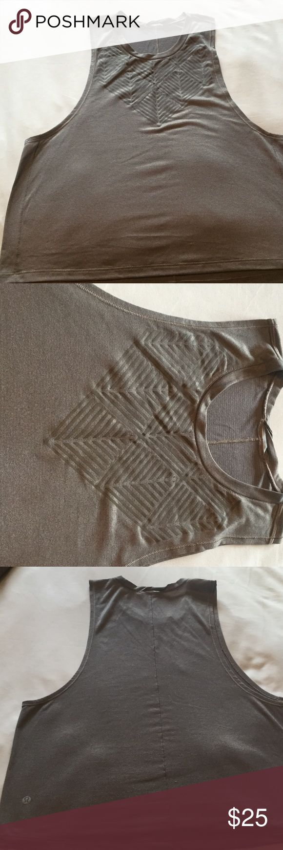 Lululemon muscle tee Gold tee with design on front. Tag is missing. It is a size 10. lululemon athletica Tops Muscle Tees