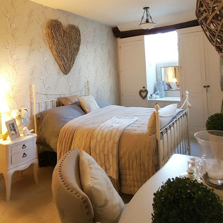 Bedroom...laura ashley wallpaper...extra large wicker heart...feeling cosy
