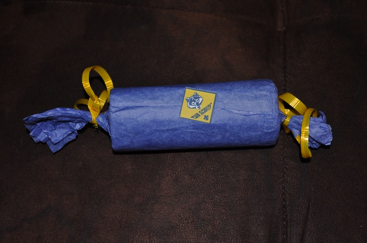 Take homes for Cub scouts blue and gold. Toilet paper rolls covered with tissue paper and tied with ribbon, stuffed with candy. Printed the cub scout symbol and used my xyron machine to make stickers. $10 for 50.