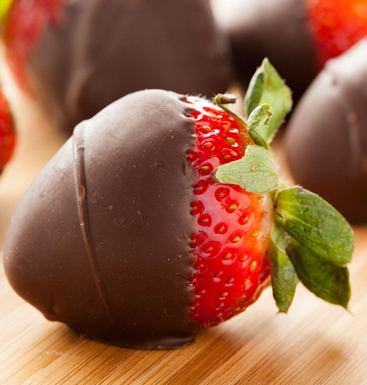 Satisfy your sweet tooth with these chocolate-covered strawberries that have less than 150 calories per serving. They make an easy, romantic dessert too! #chocolate #recipes #strawberries #desserts