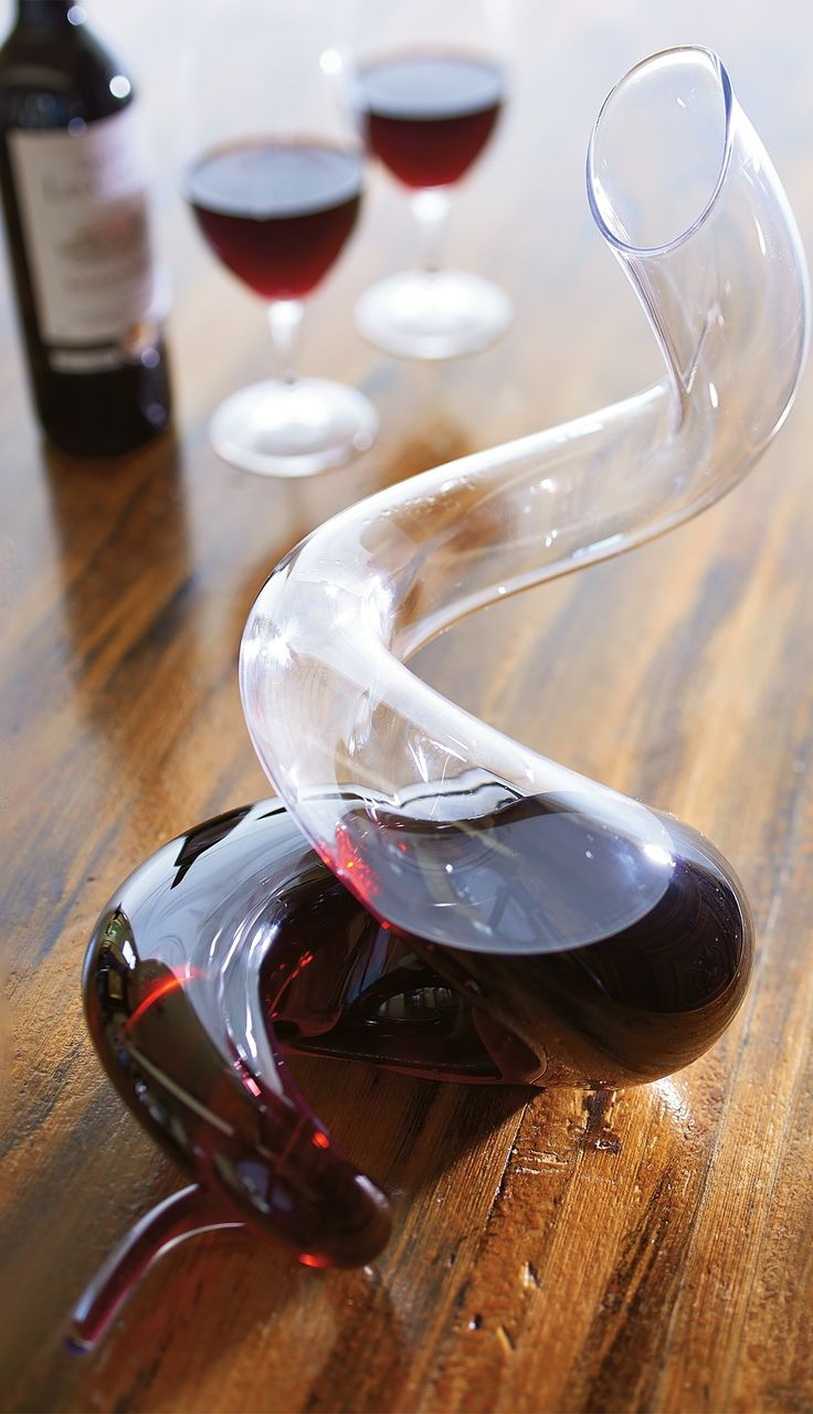 With its serpentine style consisting entirely of tight coils, the Riedel Boa Decanter double-decants wine in mere seconds, making it a stunning presentation for decanting and serving.