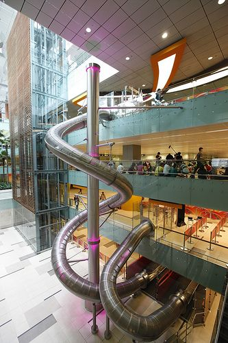 this looks like fun... spiral slide in airport in Singapore