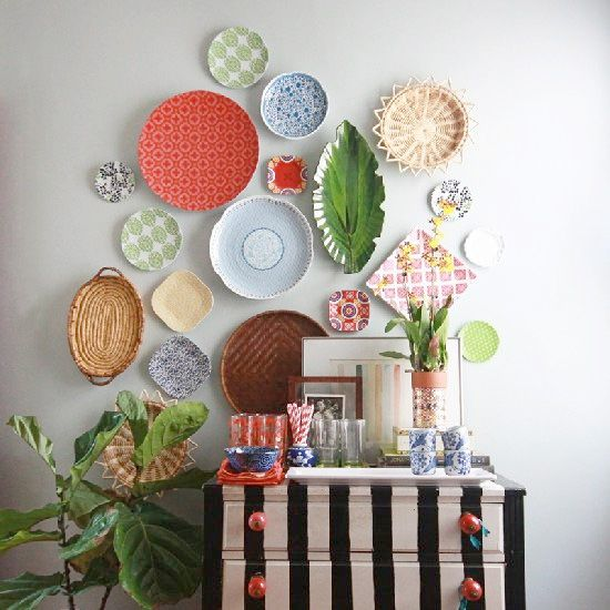 Hang serving plates on the wall above the dining nook, make sure they can be taken off and used though!