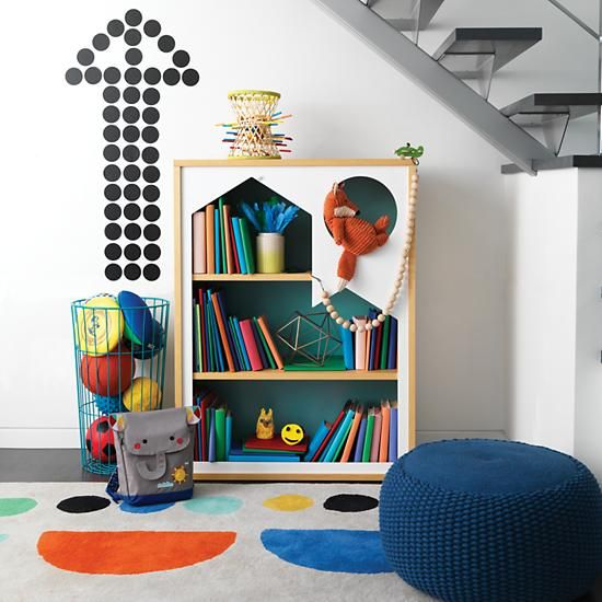 It's nice to have a library in your home, but it's just as nice to have a home in your library.  At least, that's what we were thinking when we designed this bookcase.  With a cut out house silhouette in the front, and a contrasting azure back panel, this exclusive bookcase makes a statement, and can hold books, toys and more.