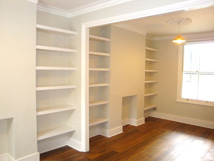 Floating shelves by London Carpenter across three alcoves