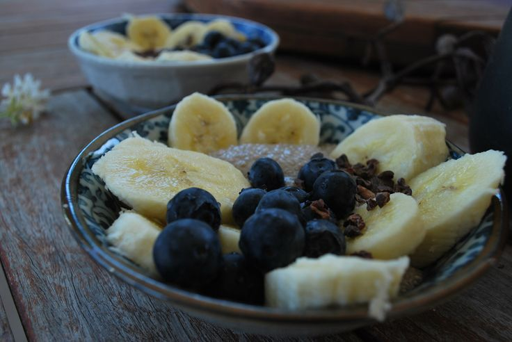 Macadamia chia pudding with cacao nibs, bananas and blueberries. Recipe at www.yourcourageousheart.com.au