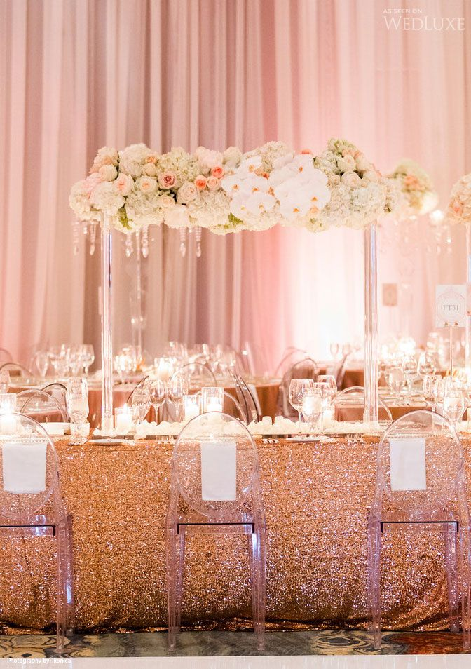 Glam wedding reception tablescape in golds & pinks with elegant white and pink flowers