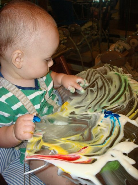 Fingerpainting with colored yogurt for BABIES....  gotta Love the creative MESS!