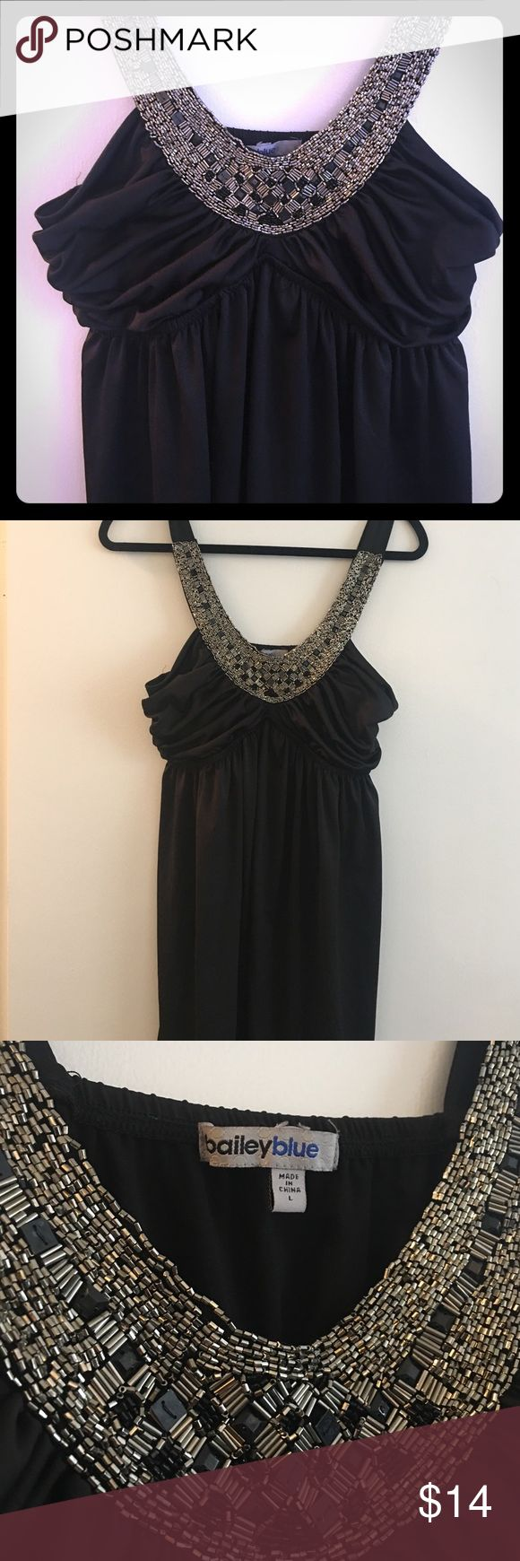 Intricately Beaded V Neck Black Dress Beautifully beaded neckline knee length dress with cinched waist. Bailey Blue Dresses