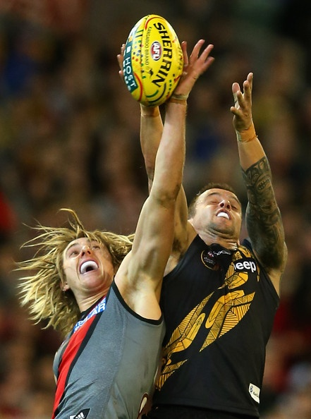 Dyson Heppell of the Bombers and Jake King of the Tigers contest for a mark during the round nine AFL match between the Richmond Tigers and the Essendon Bombers at Melbourne Cricket Ground on May 25, 2013 in Melbourne, Australia. (May 24, 2013 - Source: Quinn Rooney/Getty Images AsiaPac)
