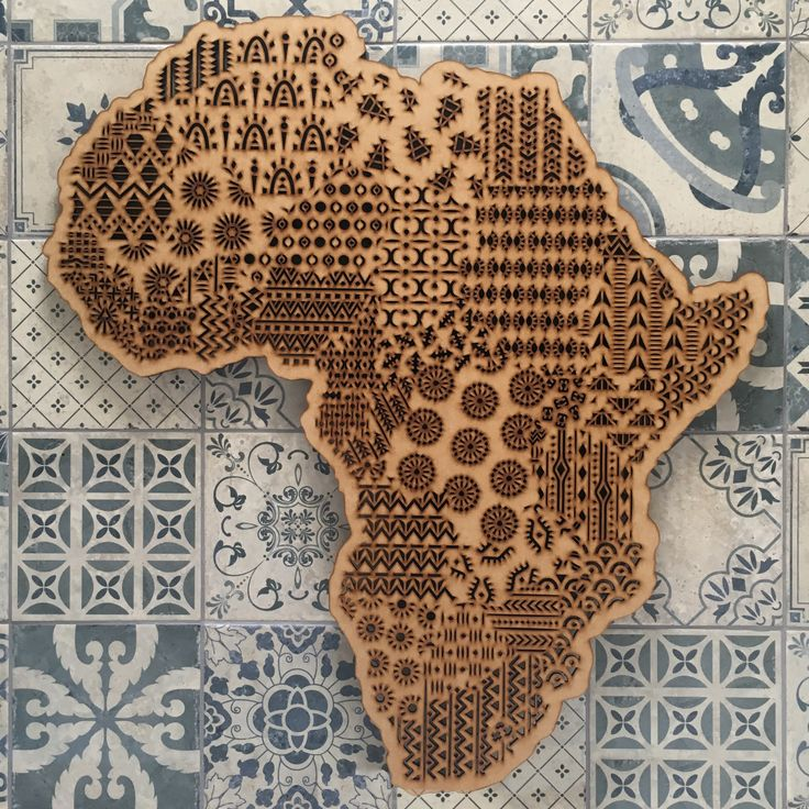 Laser cut map of Africa by Wild Minds, each country designed with inspiration taken from traditional African print. #africa #wallhanging #bohemianhome #bohemiandecor #homedecor #interiordesign #woodart #wooden #wallart #africanprint #africanart #boho #bohemian #decor #wildminds #capetown #southafrica