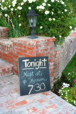 sign at the entrance of your backyard movie night