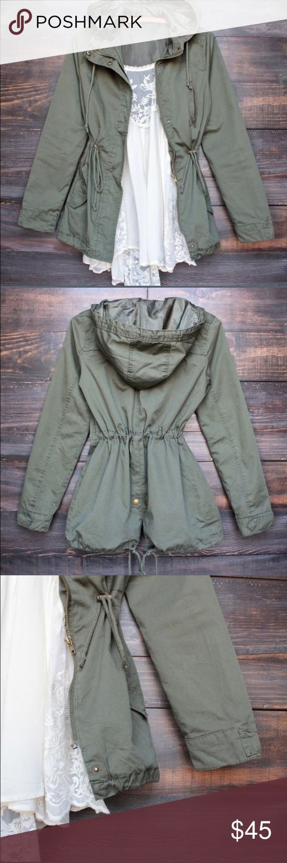 🆕Women's Hooded Green Utility Jacket Very cute and versatile this green women's utility jacket features a hood, pockets on both sides and drawstrings at waist and bottom. Zip up and fully lined. Size small and medium available. Brand new direct from distributor. Price firm unless bundled. RIIBS Jackets & Coats Utility Jackets