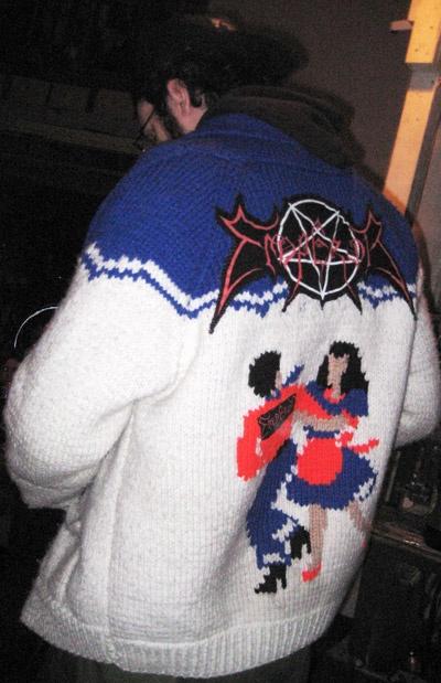 Kitschy black metal sweater.