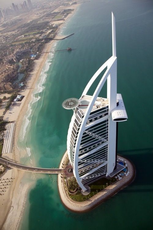 Burj Al-Arab, United Arab Emirates  (Arabic: برج العرب‎,Tower of the Arabs) is a luxury hotel located in Dubai. It has been called 'The world's only 7 star Hotel' and is the third tallest hotel in the world; however, 39% of its total height is made up of non-occupiable space. Burj Al Arab stands on an artificial island 280 m (920 ft) from Jumeirah beach and is connected to the mainland by a private curving bridge. The shape of the structure is designed to mimic the sail of a ship.