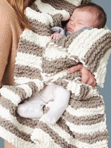 In A Wink Baby Blanket with Bernat Baby Blanket Yarn.  I don't knit but I'm sure this would be cool for crochet too!