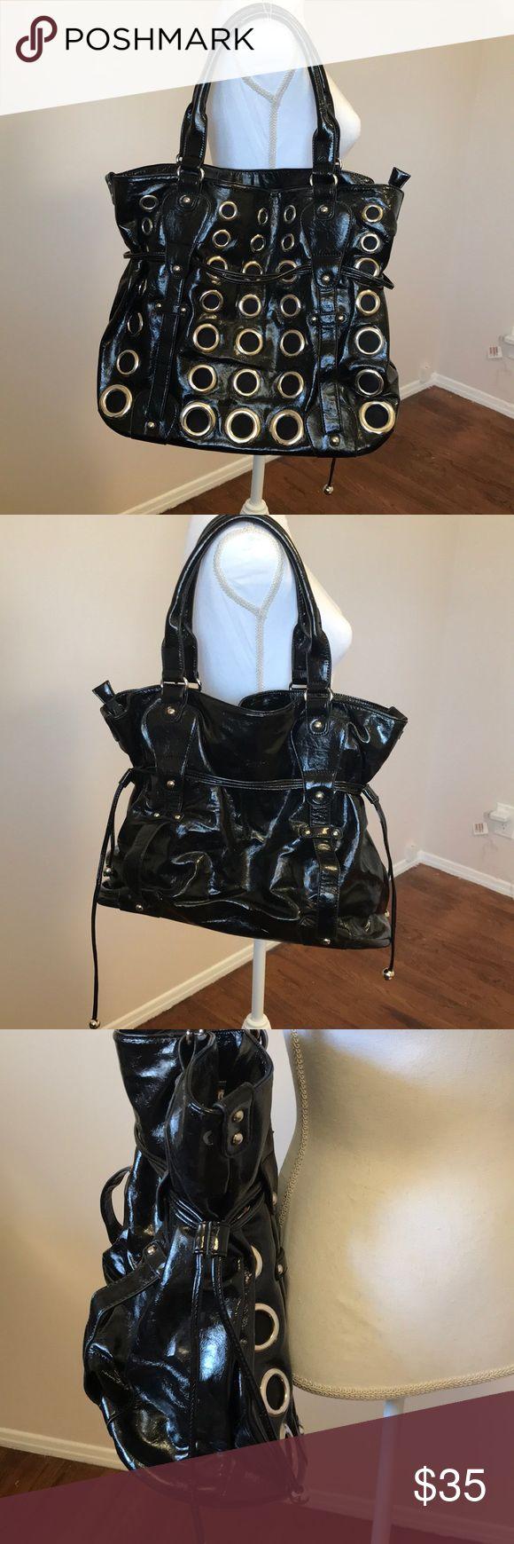 Nicole Lee Large Black Tote Bag Nicole Lee Large Black Tote Bag. NWOT  Metal rings front embellishments, side drawstrings. Nicole Lee Bags Totes
