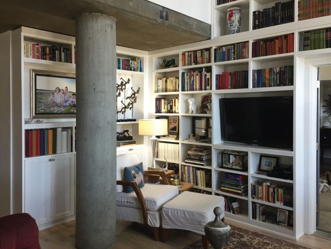 Multi use space as a media area and library storage space california closets