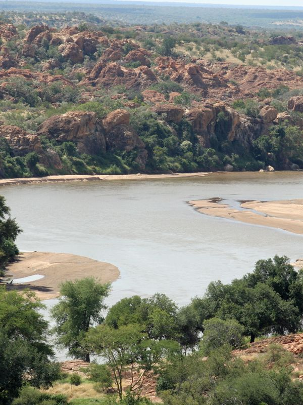 """The Limpopo River forms the border between South Africa and Zimbabwe. Rudyard Kipling immortalised the Limpopo, calling it """"the great grey-green, greasy Limpopo River, all set about with fever trees"""". Image by Andrew Mercer"""