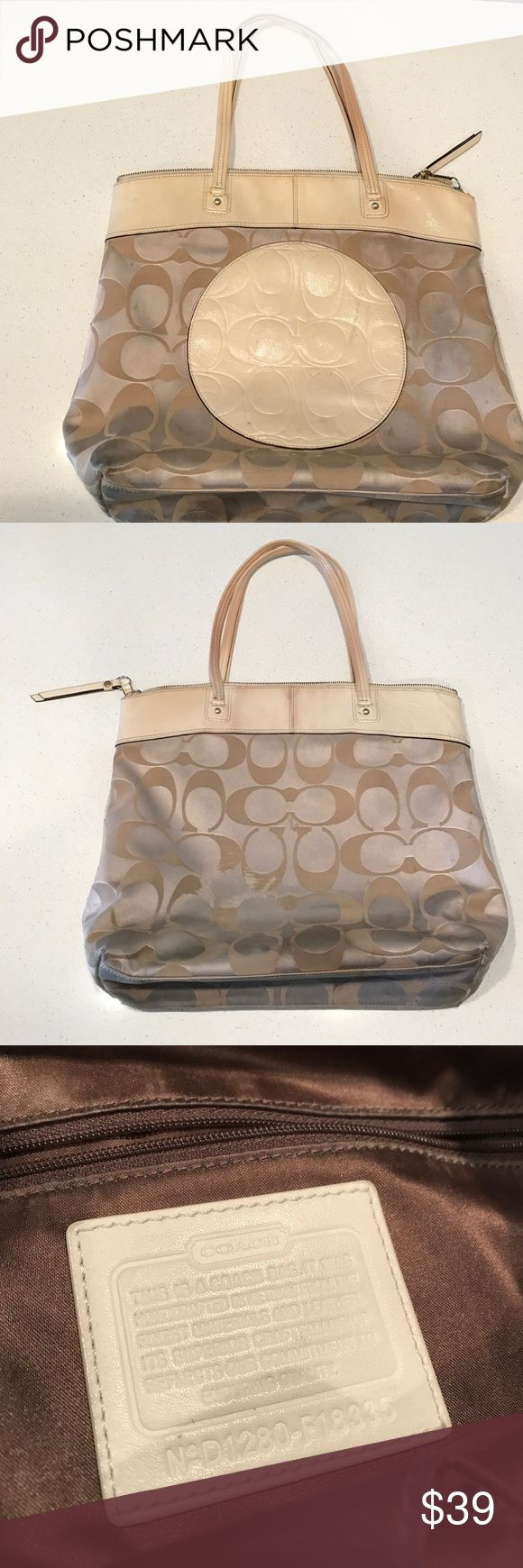 Large Coach tote bag with leather trim Large Coach cream tote bag with leather trim.  Bag has a good amount of wear but has been well taken-care-of.  There are no rips or holes inside or out. Coach Bags Totes