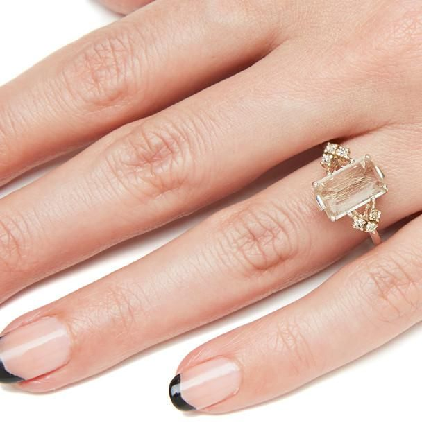 The striking Bea Arrow Ring epitomizes the Chasse collection & transforms the delicate silhouette with an 11x7mm rutilated quartz center & champagne diamonds.