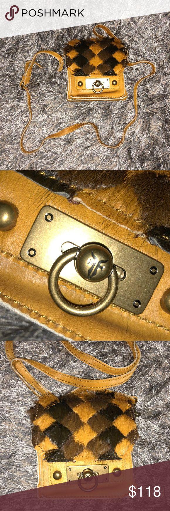 FRYE MINI FUR MUSTARD CROSSBODY BAG Brand new without tags FRYE fur mini crossbody bag. In a fun mustard color with brown and tan pattern. Gold hardware. Frye Bags Crossbody Bags