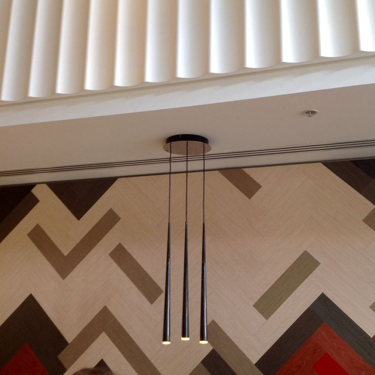 The herringbone coloured cladding of the lower wall in the Baci cafe  juxtaposes with the fluted wall detail above.