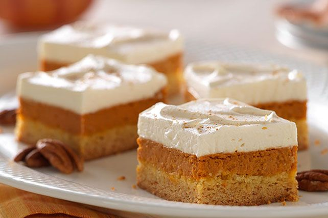 Give 'em layer upon layer of yumminess—from a buttery cake crust to a luscious pumpkin pie filling to a sweet and creamy maple-whipped topping.