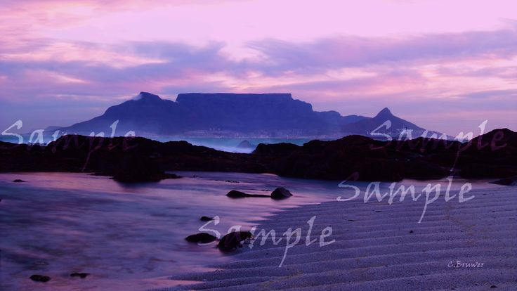 For non sample image click on the image. Image of Table Mountain in Cape Town South Africa. Unique beach, clouds and tide settings all combined in one image allows for a soft yet technical shot.