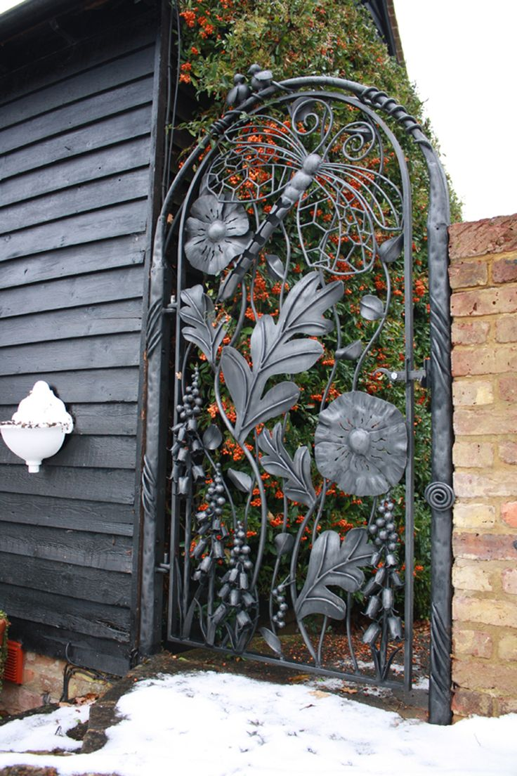 Ancanthus leaves for luck and prosperity, Foxglove and sun flowers, The Dragon fly is also a symbol of luck and the two doves as peace.. very cool gate.