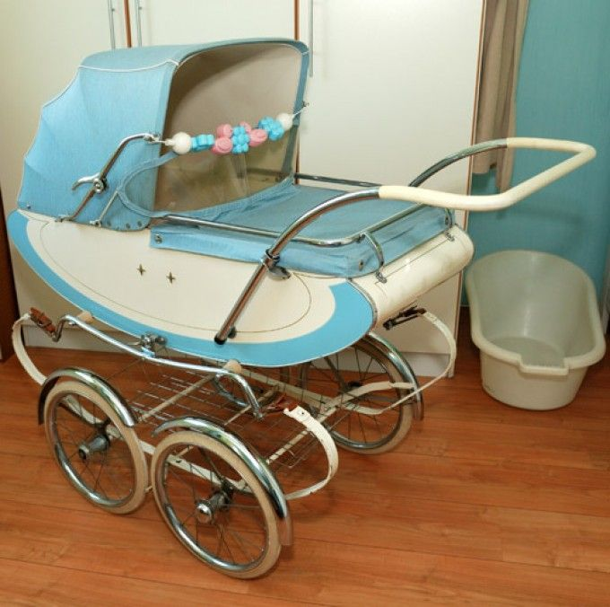 Late 50's or early 60's blue and white baby's pram.