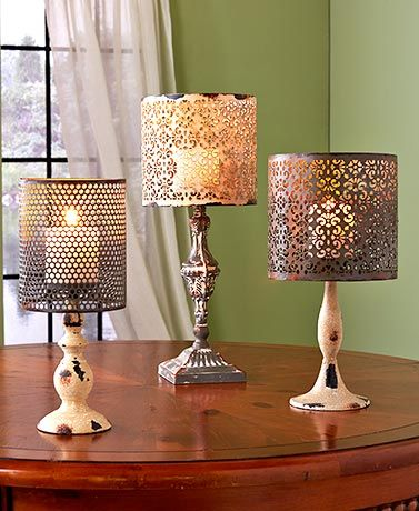 """The Metal Candle Lamp adds a vintage touch to any room. Place your own real or LED candle on the distressed cement base, and enjoy the warm glow that shines through the die-cut design on the metal shade. 14"""" lamp, 5-7/8"""" dia. x 14""""H. 15"""" lamp, 7-3/4"""" dia"""
