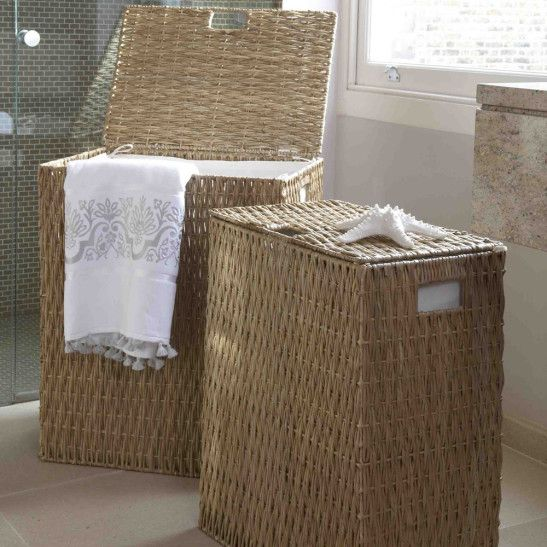 Natural coloured lined laundry baskets with a hinged lid; an ideal storage solution for your laundry room or bathroom.