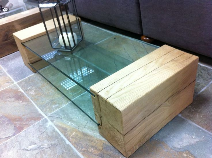 Coffee table made from new oak railway sleepers and toughened glass.
